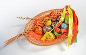 Easter eggs in wicker basket — Stock Photo