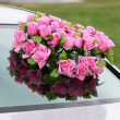Royalty-Free Stock Photo: Flowers on a car.