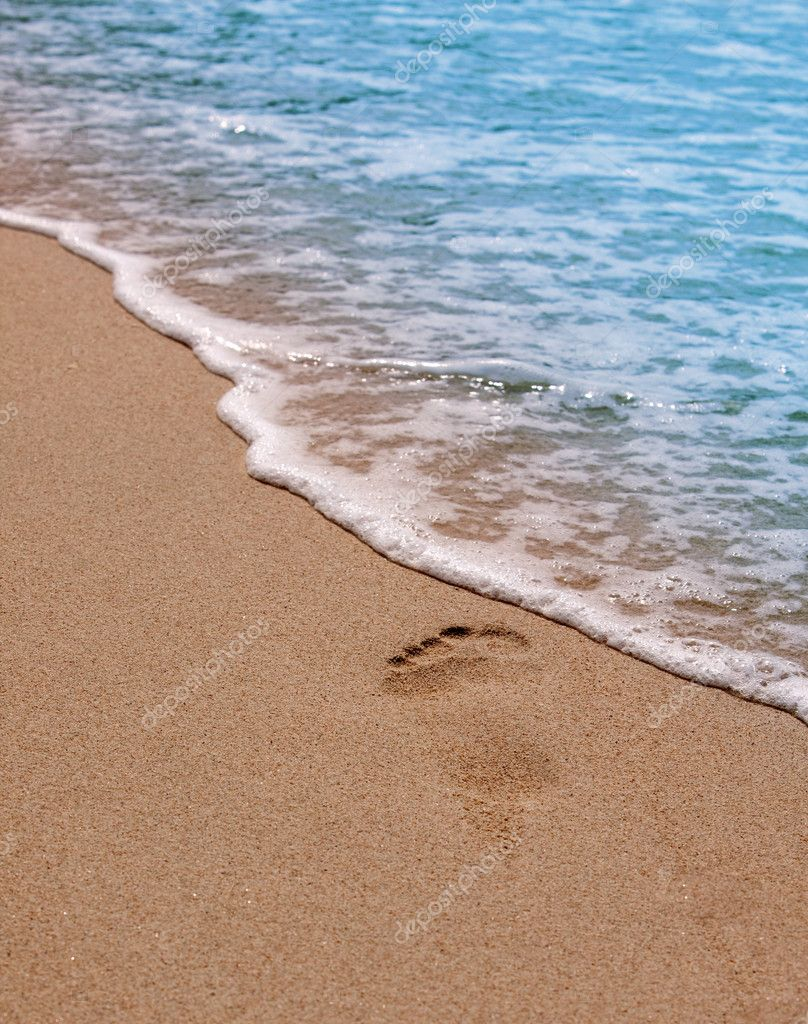 Human footprints on the beach. Sand and sea wave. — Stock Photo #8598951