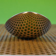 Stock Photo: Spoon on perforated steel plate