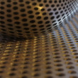 Spoon on perforated steel plate — Stock Photo