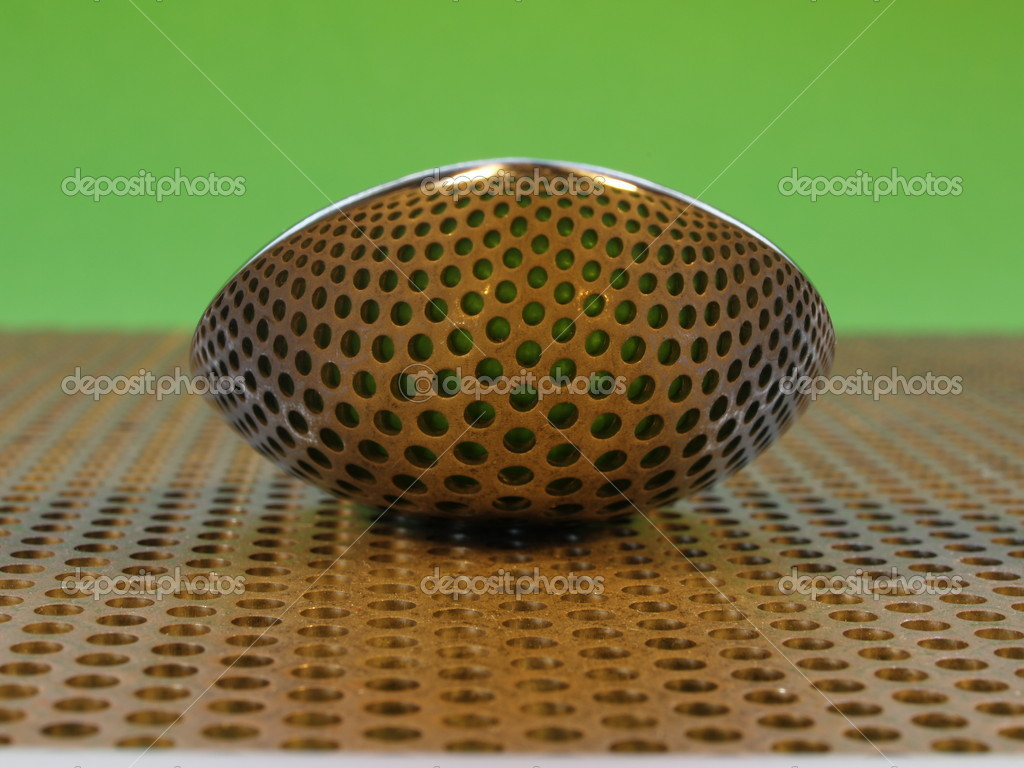 Spoon on perforated steel plate, reflecting the holes — Stock Photo #8847453