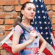 Girl with USA flag and a hammer — Stock Photo #10250023