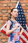 Girl with USA flag and a hammer — Stock Photo