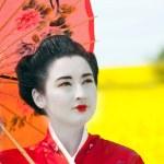 Geisha in the yellow field — Stock Photo