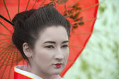 Geisha with red umbrella — Stock Photo