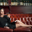Young woman with a glass of brandy — Stock Photo #9285155