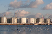 Silver tanks at the sunset — Stock Photo