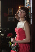 Dreamy woman in red with the rose — Photo