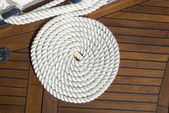 Coiled line of boat rope on deck — Stock Photo