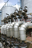 Russia. Oil and gas production. Oil tank and valve — Stock Photo