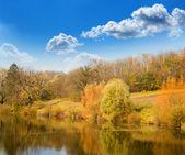 Autumn landscape on the bank of lake — Stock Photo