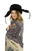 Turn around girl in earflapped fur hat — Stock Photo