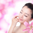 Woman smile face and close eye relax with a flower — Stock Photo