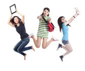 Excited group of girl students jumping — Stock Photo