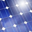 Stock Photo: Solar panel closeup with sky and sun reflection