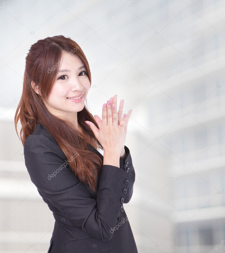 Portrait of young happy clapping business woman on office background, model is a asian beauty  Stock Photo #10591683