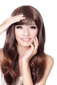 Beautiful asian woman hand touch her face — Stock Photo