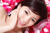 Girl smiling face with rose — Stock Photo