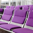 Row of purple chair at airport - ストック写真