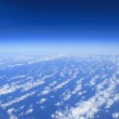 Blue sky clouds view from aircraft airplane sunny day — Stock Photo