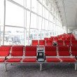 Photo: Row of red chair at airport in Hongkong