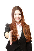 Successful business woman holds out her hand to greet — Stock Photo