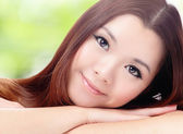 Close up of beautiful asian woman face with green background — Stock Photo