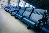 Row of blue chair at airport — Stockfoto