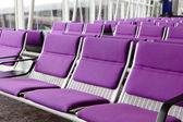 Row of purple chair at airport — Stock Photo