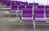 Row of purple chair at airport — Stok fotoğraf