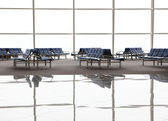 Reflection of Waiting room with blue chairs and window at airpo — Stock Photo