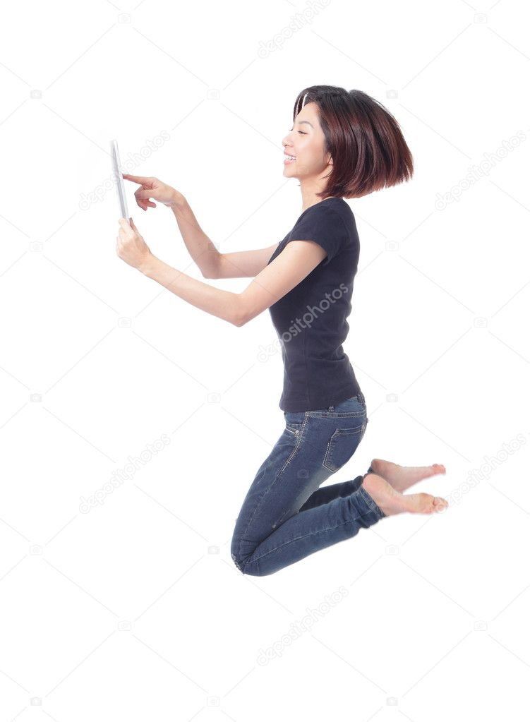 Young beauty happy jump and using tablet pc in the air isolated on white background, model is a cute asian — Stock Photo #8546372
