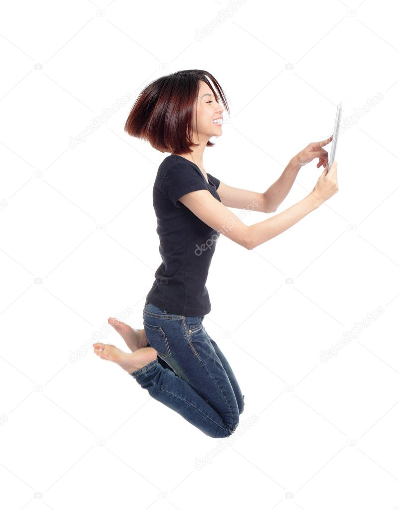 Young beauty happy jump and using tablet pc in the air isolated on white background, model is a cute asian — Stock Photo #8546373