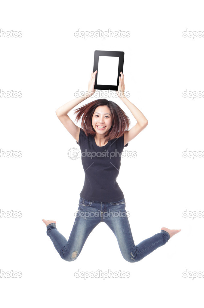 Young beauty happy jump and showing tablet pc in the air isolated on white background, model is a cute asian  Stock Photo #8546380