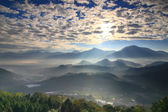 Sun shines in the morning with mountains — Stock Photo