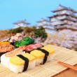Tasty japan sushi with Japanese style castle — Stock Photo