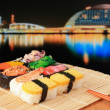 Stock Photo: Delicious Japanese sushi mix with beautiful japan night scenes
