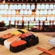 Stok fotoğraf: Delicious Japanese sushi mix with beautiful japan night scenes