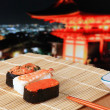 Delicious Japanese sushi mix with beautiful japan night scenes — Stock Photo