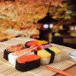 Delicious Japanese sushi mix with beautiful japan night scenes — Stock fotografie