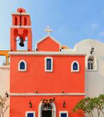 Krásný kříž a oranžové s modré nebe a bílé clou — Stock fotografie