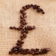Coffee beans on linen background (franc shape) — Stock Photo