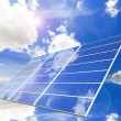 Solar Panel with reflection of blue sky and white cloud — Stock Photo #8607431
