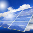 Solar Panel with reflection of blue sky ,white cloud and sun — Stock Photo