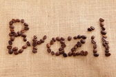 Coffee beans on linen background ( Brazil Text symbol) — Foto Stock