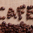 Coffee beans on linen background — Stock Photo #8639841