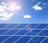 Solar Panel with sunlight and blue sky background — Stock Photo