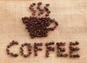Coffee beans on linen background — Stock Photo
