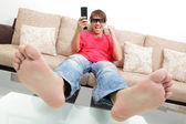 Exciting young man watch 3D LCD TV with eye glass — Stock Photo